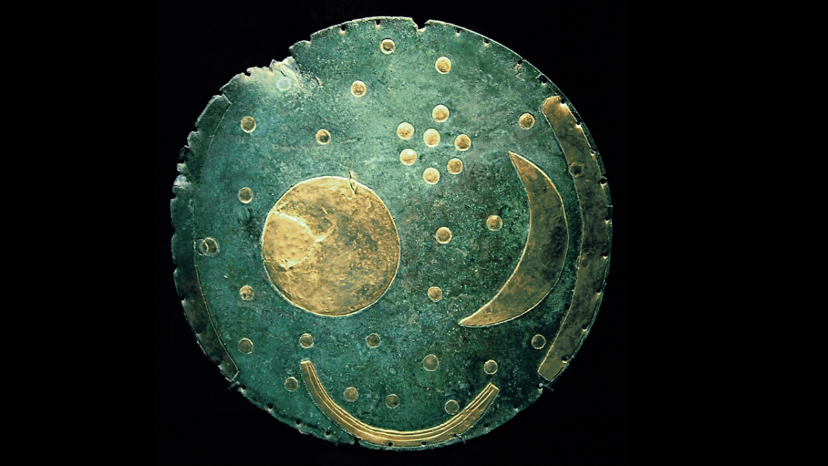The Nebra sky disk, a Bronze or Iron Age artifact found in Germany and believed to be one of the world's oldest depictions of the sky. Image credit: Dbachmann via Wikimedia Commons (CC BY-SA 3.0).