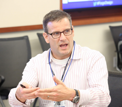 Candid portrait of Duke Psychiatry's Scott Kollins, PhD, discussing a project at the Duke Forge Design Workshop